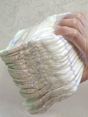 Взятие памперсов для укладки в торт